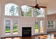 Living room in a ranch model with high ceiling.