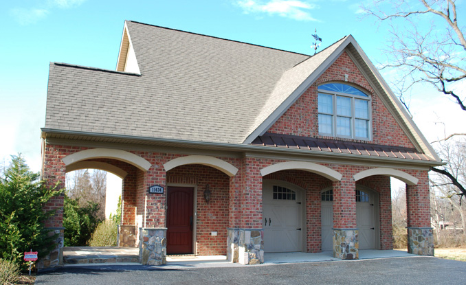 A historic carriage house, currently the Willow Ridge Sales Center.