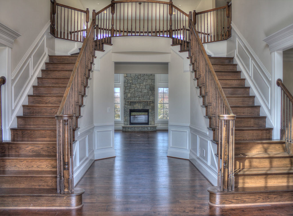 Remington 2-story foyer with double staircase and upper landing.