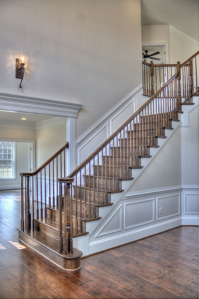Complete staircase, towards Living Room. Upper landing visible.